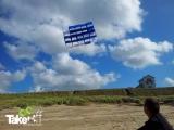 <h5>Teamvlieger van SIDN</h5><p>De vlieger wordt gezamenlijk naar beneden gehaald.</p>
