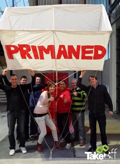 3D Reuzevlieger teamfoto bij bedrijfsuitje van Primaned